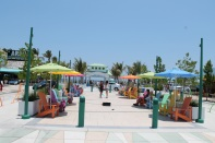 Extending from the pavilion, this paved area is lined with colorful Adirondack chairs, and umbrellas. Beachgoers utilized the space to play bags and giant Jenga.